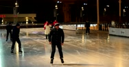 People ride on skates, one of them falls to the ice Stock Footage