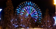 Colored lights shimmering Ferris wheel at VDNKH in the dark Stock Footage