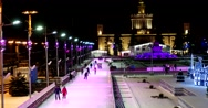 Colorful light installations, people skate on the ice rink ENEA Stock Footage