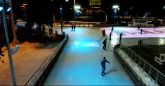 Top view, young people skating on the ice rink Stock Footage