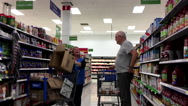 Customer asking clerk about electric appliance direction inside Walmart store Stock Footage