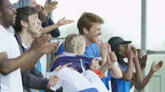 4K Crowd of spectators cheering at sports event with flags of different nations Arkistovideo