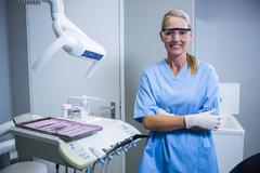 Smiling dental assistant with protective glasses at the dental clinic Stock Photos