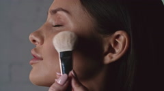 Contouring Cheeks with Bronzer Stock Footage