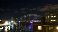 Night scene with New Years Eve fireworks display on Sydney Harbour Bridge. Stock Footage