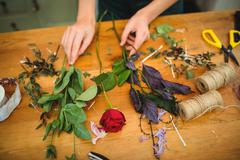Close-up of female florist preparing a flower bouquet at her flower shop Kuvituskuvat