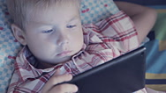 Close-up of kid face looking at tablet computer Stock Footage