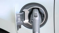 Charging electric car in residential garage. Stock Footage