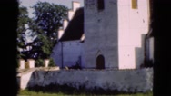 1948: panoramic view of an old church located next to cemetery  Stock Footage