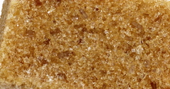 Brown Cube Sugar against White Background, Real Time 4K, Moving image Stock Footage