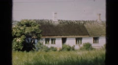 1948: an old building dilapidated and ran down in an abandoned grassy field. Stock Footage