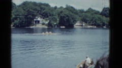 1951: canoeing competition stirs the city during the weekend in the lagoon city Stock Footage
