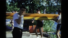 1951: training for canoeing games athletes prepare equipment  Stock Footage