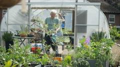 4K Cheerful volunteers in community garden working, dancing & having fun Stock Footage