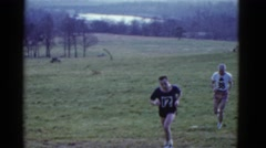 1951: cross country runners trek through field during race DANVILLE, ILLINOIS Stock Footage