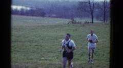 1951: two guys running outdoor DANVILLE, ILLINOIS Stock Footage