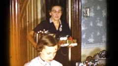 1951: grandma dropping off wrapped christmas gifts DANVILLE, ILLINOIS Stock Footage