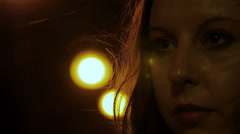 Shocked woman with a blank stare in the street at night Stock Footage
