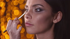 Doing Makeup for a Model Stock Footage
