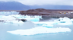 Iceberg floating at Jokulsarlon in southern Iceland Stock Footage