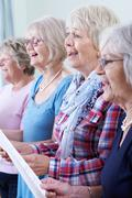 Group Of Senior Women Singing In Choir Together Stock Photos