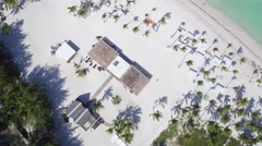 Straw restaurant on the shores of the Caribbean Sea, white sand beach, palm tree Stock Footage