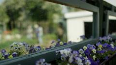 4K Volunteers working in community garden, reflected view seen through a mirror Stock Footage