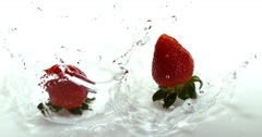Strawberries, fragaria vesca, Falling on Water, Slow Motion 4K Stock Footage