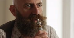 4k, Person smoking an e cigarette. Stock Footage