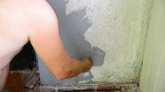 Man plastering with a spatula wall Stock Footage