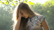 Girl playing with her hair Stock Footage