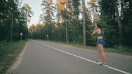 Woman running in park exercising outdoors. Healthy lifestyle Stock Footage