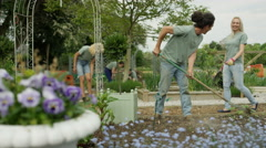 4K Cheerful team of volunteers working together in community garden Stock Footage