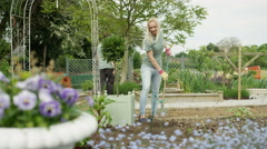 4K Portrait smiling volunteer working as part of a group in community garden Stock Footage