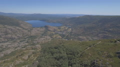 Flying off Sanabria Lake Stock Footage