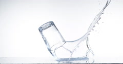 Glass Falling and Water splashing against White Background, Slow Motion 4K Stock Footage