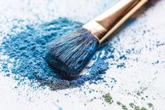 Scattered blue eye shadows close-up Stock Photos