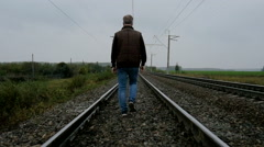 Man walking on the railroad Stock Footage