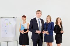 Portrait smiling businessman with his business, positeve team. Group of busin Kuvituskuvat