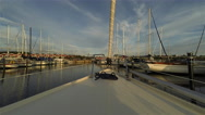 Time lapse of sailboat entering port Stock Footage