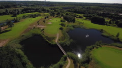 Aerial golf course and players. Stock Footage