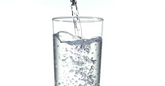 Water being poured into Glass against White Background, Slow Motion 4K Stock Footage
