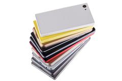 Pile of mobile phone. Heap of the different smartphones isolated on white bac Stock Photos