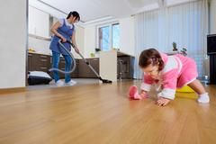 Baby does cleaning with my mother in the house. Stock Photos