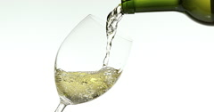 White Wine being poured into Glass, against White Background, Slow motion 4K Stock Footage