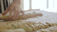 Housewife lines up homemade cookies on a cloth Stock Footage