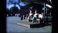 1963: lovely video of two women enjoying day outdoor, while sitting on bench. Stock Footage