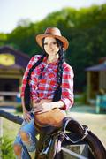 Western,cowboy,cowgirl,rodeo.Cowgirl in western style on the farm. Kuvituskuvat