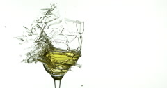 Glass of White Wine Breaking and Splashing against White Background, Slow motion Stock Footage
