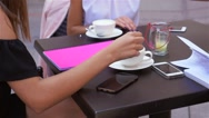 Three young women are sitting at café restaurant. Outdoor background Stock Footage